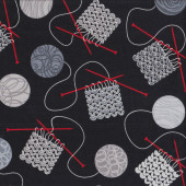 Knitting Needles Balls of Yarn on Black Quilting Fabric