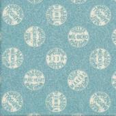 Sewing Spools on Blue Quilting Fabric